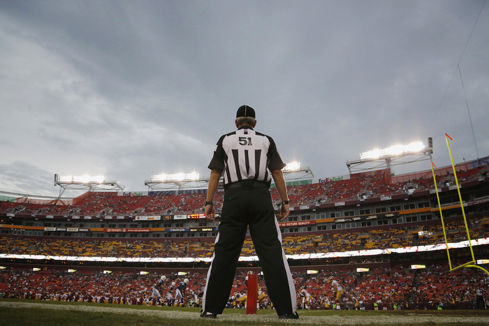 Referee takes his position on sideline during an NFL preseason football game between the Indianapolis Colts and Washington Redskins in Landover, Maryland
