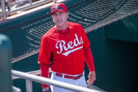 Former pitching coach Bryan Price will try to lead the Reds to their first postseason series win since 1995. (Rob Tringali/Getty Images)