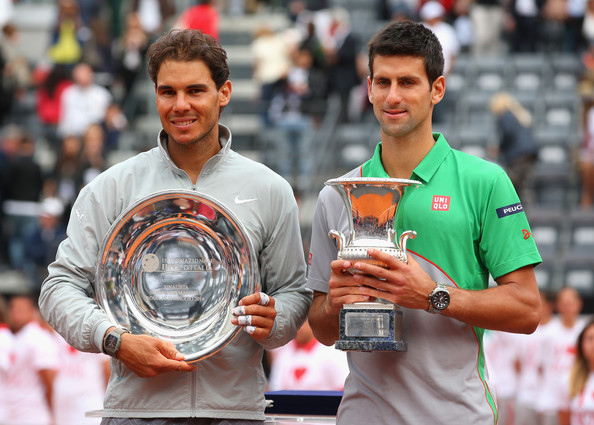 Is it possible that Novak Djokovic will hold the champions trophy while Rafael Nadal claims runner-up hardware, like what just happened at the Italian Open?  Djokovic is looking to complete the career Grand Slam with a victory in Paris. (Julian Finney/Getty Images)