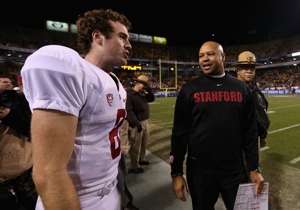 After four straight BCS Bowl appearances, Stanford head coach David Shaw (r.) and returning quarterback Kevin Hogan are ready to defend their back-to-back Pac-12 titles (Christian Petersen/Getty Images)