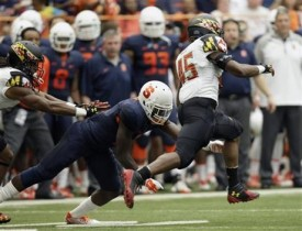 Maryland's Brandon Ross (45) eludes a would-be Syracuse tackler on his way to a 91-yard touchdown reception in the first quarter. (Nick Lisi/AP Photo)