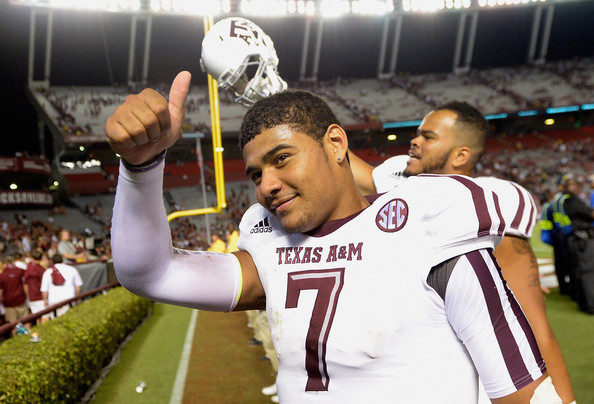 Texas A&M quarterback Kenny Hill deserved a big thumbs-up after his 511-yard passing performance in his collegiate debut at South Carolina. (Grant Halverson/Getty Images)