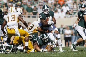 Jeremy Langford hadn't run for over 100 yards in his last four games until his 137-yard effort last week vs. Wyoming. (Photo: MLive.com)