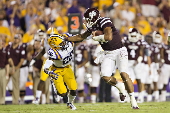 The stellar performance by Mississippi State quarterback Dak Prescott in the Bulldogs' win in Baton Rouge on Sept. 20 launched the team into the SEC and national championship pictures. (Wesley Hitt/Getty Images)