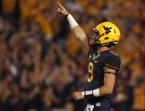 After an injury-plagued and up-and-down 2013 in Morgantown, Florida State transfer quarterback Clint Trickett has saved his best play for his final season on campus in 2014. (Getty Images)