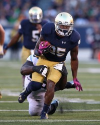 Giving the Irish a spark out of the backfield, Tarean Folston broke out vs. UNC, going for 169 total yards and 3 TDs. (Jonathan Daniel/Getty Images)