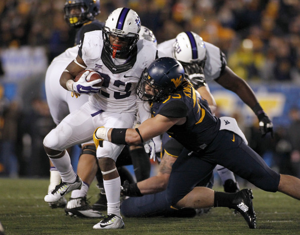 Running back B.J. Catalon (l.) and the rest of the Horned Frogs offense have made mincemeat of opposing defenses, averaging 550 yards per game, ranking third in the FBS. (Justin K. Aller/Getty Images)