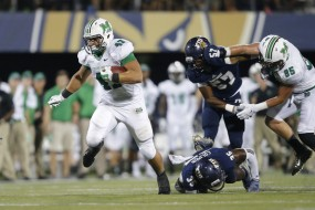 Overshadowed by his backfield mate Rakeem Cato, RB Devon Johnson  (Joel Auerbach/Getty Images)