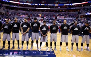 "The Georgetown basketball team stood during the national anthem wearing ""I Can't Breathe"" T-Shirts before tonight's game vs. Kansas. (Nick Wass/AP)"
