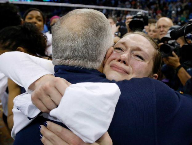 National volleyball  Player of the Year Micha Hancock (r.) hugs her head coach, Russ Rose, after Penn State won its second consecutive national title on Saturday vs. BYU (Sue Ogrocki/AP)