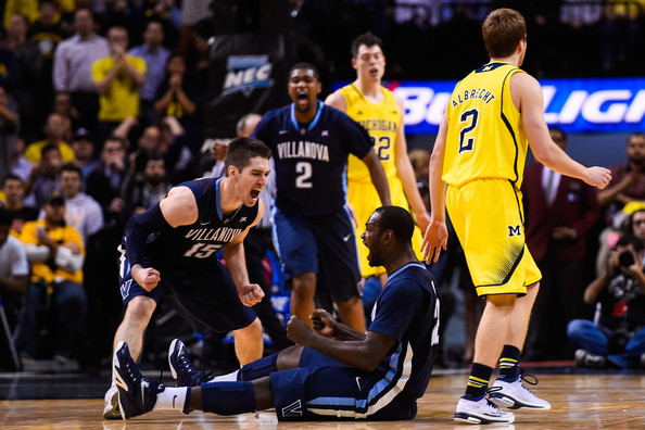 Led by Ryan Arcidiacono (l.) and JayVaughn Pinkston (sitting), Villanova impressed in Brooklyn at the Progressive Legends Classic, taking out both VCU and Michigan on its way to the title. (Alex Goodlett/Getty Images)