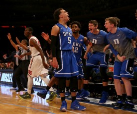 Duke guard Tyus Jones scored 13 of his 22 points after halftime, including the late-game three that helped seal the Blue Devil  victory. (Elsa/Getty Images)