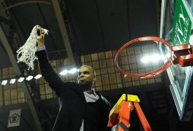 Harvard head coach Tommy Amaker cuts down the nets at The Palestra after his fifth Ivy League title with the Crimson. (Michael Perez/AP)