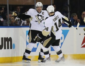 Sidney Crosby needs help. Maybe Chris Kunitz can provide it! (Bruce Bennett/Getty Images)