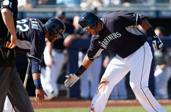 To address the woes at the DH position last season - as well as to give Robinson Cano (l.) protection in the batting order - the Seattle Mariners went out and acquired Nelson Cruz. (Christian Petersen/Getty Images)