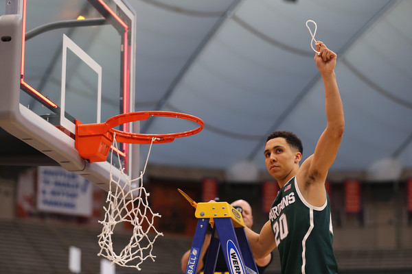 In four NCAA Tournament games, Trice averaged 20 points per game and hit 13 three-pointers on his way to winning the East Region's Most Outstanding Player (Maddie Meyer/Getty Images)
