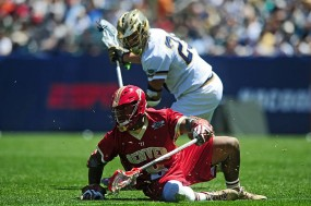 Trevor Baptiste (No. 9 in red) won 15 of the 24 face-offs in Denver's win over the Irish. (Photo: DU Men's Lacrosse)
