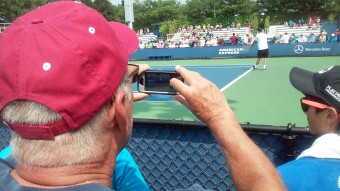 Matt's father-in-law, Paul, taking a picture of Matt serving...