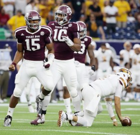 Myles Garrett (No. 15), a consensus Freshman All-American in 2014, had two of A&M's nine sacks last week against Arizona State. (Scott Halleran/Getty Images)