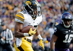 Iowa has had many players step, including RB Akrum Wadley, who replaced an injured Jordan Canzeri and ran for 204 yards vs. Northwestern on Oct. 17.  (Jon Durr/Getty Images)