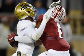 Somehow, Stanford wide receiver Francis Owusu (r.) pulled down this ball for a touchdown in last night's blowout of UCLA. (Thearon W. Henderson/Getty Images)