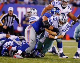 Matt Cassel had a rough go of it in his first start as a Cowboy, throwing three interceptions. (Al Bello/Getty Images)