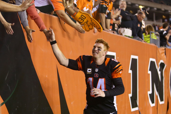 Andy Dalton threw three touchdown passes in Thursday's win against the Browns, the fourth time this season he's thrown that many TDs in a game. (Andrew Weber/Getty Images)