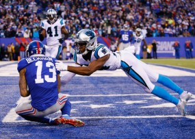 In one of the few instances Odell Beckham and Josh Norman didn't come to blows, Beckham caught the game-tying touchdown pass to tie. (Al Bello/Getty Images)
