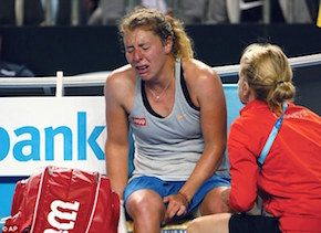 The anguish on Friedsam's face was apparent as she struggled with cramp at the end of her match with Aga Radwanska. (AP)