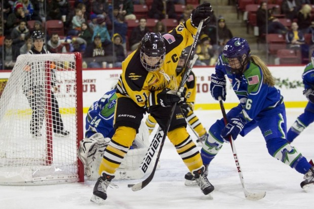 As the inaugural Isobel Cup Playoffs get underway this weekend, Hilary Knight (c.) and her top-seeded Boston Pride team are the favorites to take home the trophy, but  it's far from a sure thing. (Michelle Jay/Along the Boards)