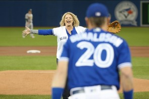 Lisa French got the chance to throw out the ceremonial first pitch to her son, who happens to be last season's AL MVP. (Tom Szczerbowski/Getty Images North America)