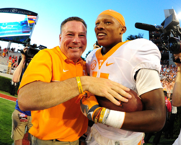 Tennessee head coach Butch Jones and quarterback Joshua Dobbs have had a lot to celebrate over the past few seasons, but have yet to celebrate a win against a Top 10 team yet. (Scott Cunningham/Getty Images)