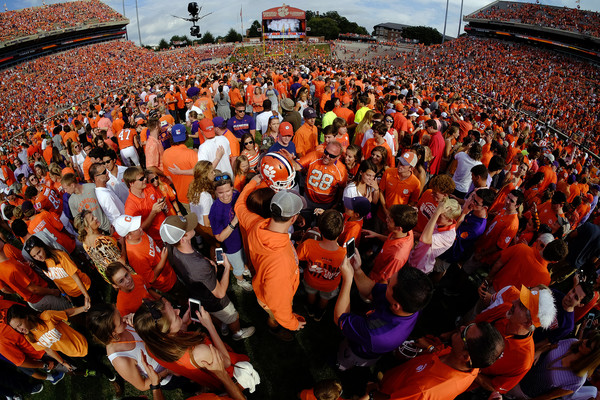 It was, at best, peculiar to see the home fans of a Top 5 team rush the field after a win against an unranked opponent. But Clemson fans also knew that their close call last week against NC State almost derailed its national championship aspirations. (Todd Bennett/Getty Images)