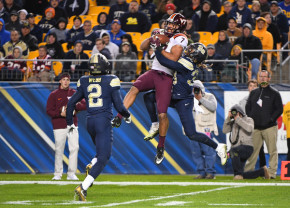 At 6-foot-7, Bucky Hodges (No. 7 in white) is always an inviting target in the Hokies' passing attack. (Justin Berl/Getty Images)