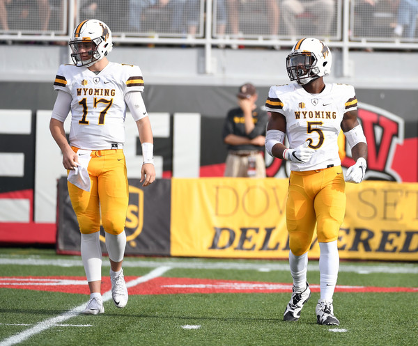 The 23 touchdown passes from Josh Allen (l.) and the 1,548 rushing yards of Brian Hill have been two of the main reasons Wyoming is one step away from the Mountain West Championship Game. (Ethan Miller/Getty Images)