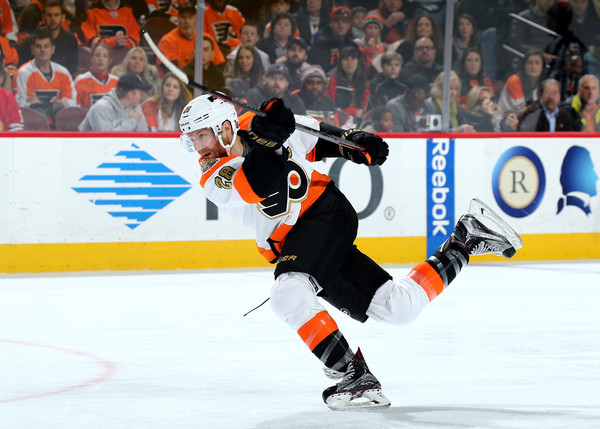 While getting every ounce of energy on his slapshot sometimes leaves Claude Giroux head over heels on the ice, his recent play (12 points in last 10 games) has left his opponents doubled over. (Elsa/Getty Images)