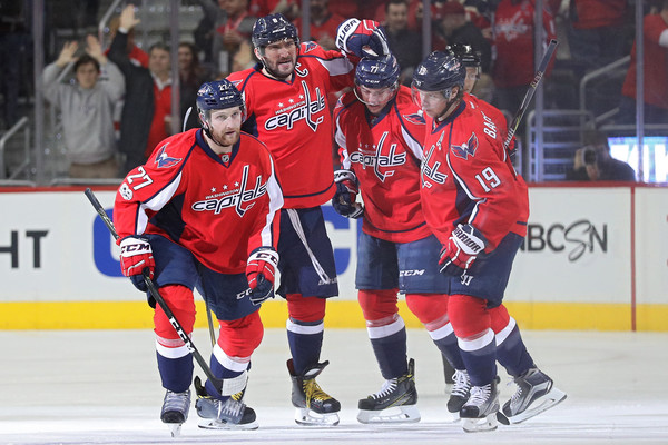 TJ Oshie (second from right) and the rest of the Capitals celebrate their fast start tonight against the Boston Bruins. (Patrick Smith/Getty Images)