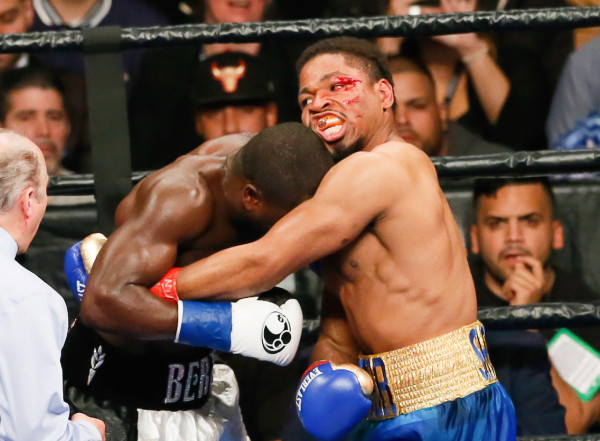 Shawn Porter (r.) succeeded in his strategy of smothering Andre Berto's offensive power, but Porter did catch a few head-butts in the process, including one that opened up a nasty gash in the third round. (Robert Cole/ALOST)
