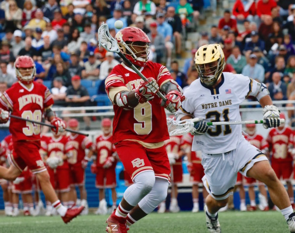 Trevor Baptiste showed today why he is a Tewaaraton Award finalist, winning 21 of 22 face-offs - including his last 21 draws at the X - in Denver's 16-4 demolition of Notre Dame. (Robert Cole/ALOST)