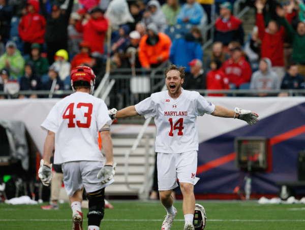 It was party time for tournament Most Outstanding Player Tim Muller (14) and the Terrapins as the clocked hit zero, as they won the school's first national championship since 1975 win today's win over Ohio State. (Robert Cole/ALOST)