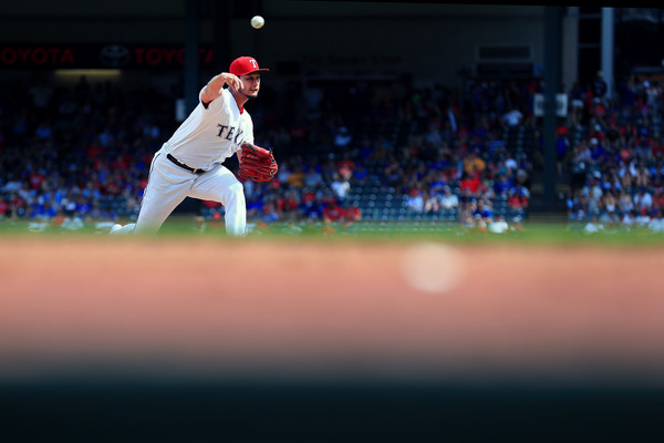 Yu Darvish and the Rangers had to fight an uphill battle from the first inning on despite his quality start against the Angels. (Tom Pennington/Getty Images)