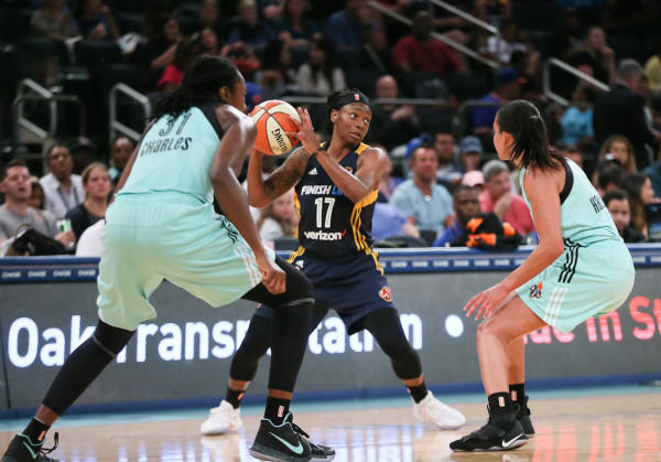 It almost did not matter whether there were one or two (or more) defenders on Fever guard Erica Wheeler, who, in a losing effort, scored 33 points against New York on Tuesday. (Robert Cole/ALOST)