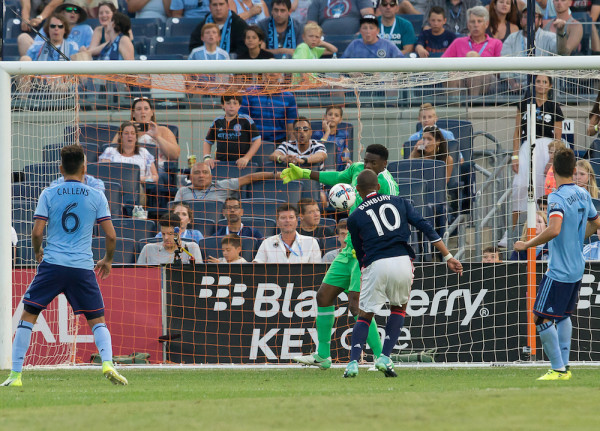 NYCFC goalkeeper Sean Johnson (green) was made to pay for one of his rare errors this season, as Teal Bunbury scored on a rebound just seconds after this shot to draw first blood in the game on Sunday. (Robert Cole/ALOST)